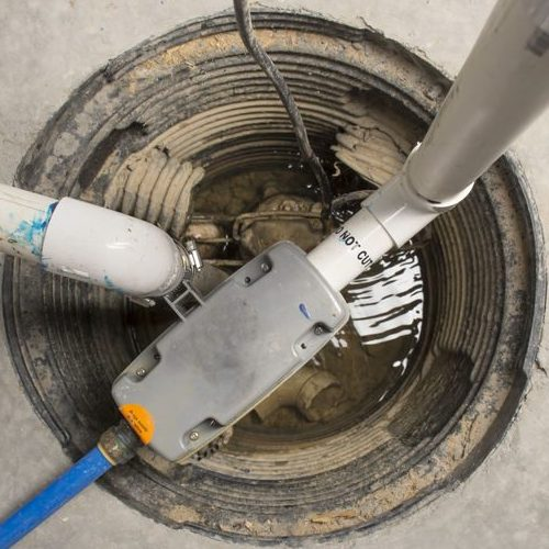 A Picture of a Sump Pump Installed in a Basement with a Water Powered Backup System.