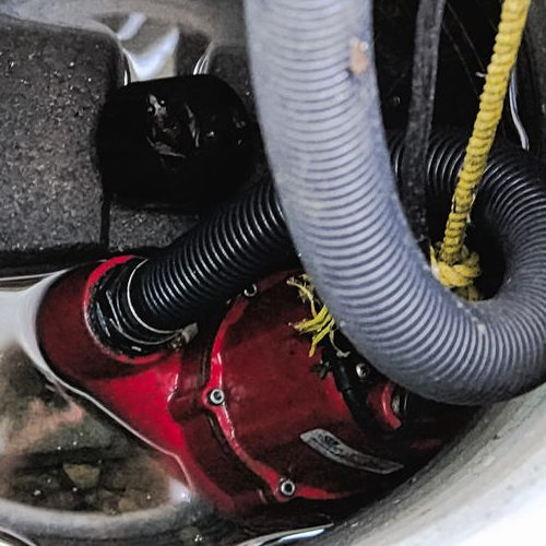 A Picture of a Sump Pump Surrounded By Water.